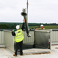 equipment access hatch being used to transfer large equipment to and from building via the roof