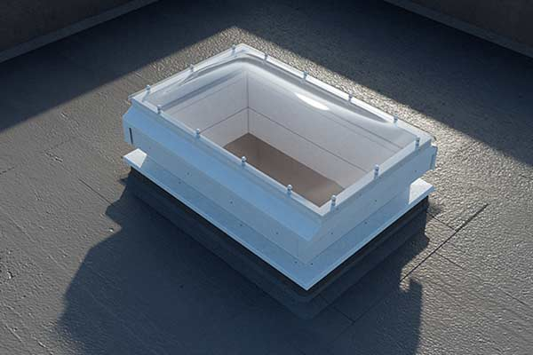 sliding skylight roof access hatch on flat roof in closed position