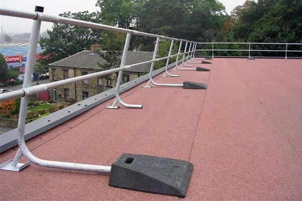 roof edge protection guardrail on top of industrial building