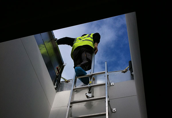LadderUP Safety pole for easy access through a roof hatch or floor door from a fixed ladder